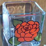 """RED FLOWER"" 3"" candle holder painted with a delicate rose design. Piece was baked for added durability."