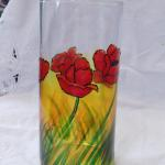 """POPPIES"" Brilliant red poppies on layers of warm colors painted on a clear 7"" tall clear vase. The piece was then baked for added durability."
