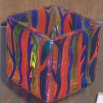 """STRIPES"" 3"" candle holder painted with bold multi-color paints on a textured glass surface. Piece was baked for added durability."