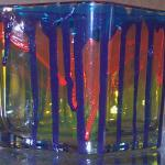 """PAINT RUN WILD"" 3 1/2"" glass candle holder. Layers of paints brushed on and allowed to run to complete their own design. Baked for added durability."